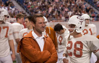 Aaron Eckhart as Darrell Royal and Finn Wittrock as Freddie Steinmark in