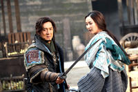 Jackie Chan as Huo An and Mika Wang as Xin Qing in