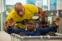 Dwayne Johnson as Bob Stone and Kevin Hart as Calvin in