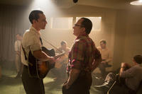 Tom Hiddleston as Hank Williams and Bradley Whitford as Fred Rose in