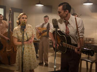 Elizabeth Olsen as Audrey Williams and Tom Hiddleston as Hank Williams in