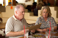 Stacy Keach as Lt. Colonel Bill Burkett and Noni Hazlehurst as Nicki Burkett in
