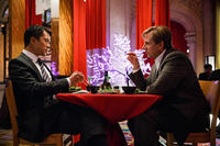 Steve Carell as Mark Baum and Byron Mann as Mr. Chau in