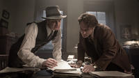 Colin Firth as Max Perkins and Jude Law as Thomas Wolfe in