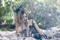 India Eisley as Sleeping Beauty in