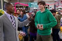 Jamie Foxx as Kelvin Moore and Ashton Kutcher as Reed Bennett in