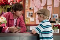 Ashton Kutcher as Reed Bennett and Bryce Robinson as Edison in
