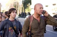 John McClane (Bruce Willis) and Matt Farrell (Justin Long) try to make sense of the increasing chaos around them in