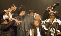 Jamal Woolard, Derek Luke and other performers on stage in
