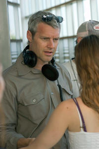 Director Neil Burger on the set of