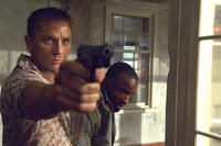 Bond (Daniel Craig) takes Mollaka (Sebastien Foucan) as a hostage in