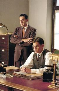 Assistant Ray Brocco (John Turturro) and agent Edward Wilson (Matt Damon) in
