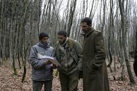 Director Rachid Bouchareb, Sami Bouajila and Roschdy Zem on the set of