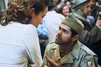 Saïd (Jamel Debbouze) tells a French woman about his battle victory in