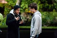 Director Jonathan Kasdan with Adam Brody on the set of