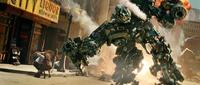 An Autobot, Ironhide, does battle with the destructive Decepticons in