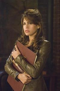 Eva Mendes as reporter Roxanne Simpson in