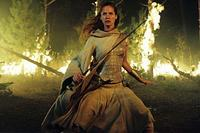 The warrior Arya (Sienna Guillory) faces a deadly enemy in