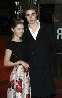 Actor Jeremy Irons' son Max and his guest Georgie Pownall at the London premiere of