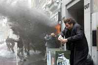 Clive Owen ducks a bomb blast in