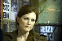 Julianne Moore as underground opposition leader Julian in
