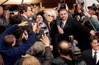 Fashion magazine editor Miranda Priestly (Meryl Streep) makes her way through a phalanx of paparazzi in