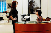 First assistant Emily (Emily Blunt) admonishes newbie second assistant Andy (Anne Hathaway) in