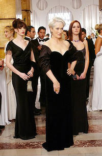 Miranda Priestly (Meryl Streep) is flanked by her two assistants, Andy (Anne Hathaway) and Emily (Emily Blunt) in