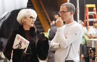 Meryl Streep reviews a scene with director David Frankel on the set of