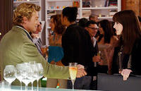 Andy (Anne Hathaway) meets famed writer Christian Thompson (Simon Baker) in