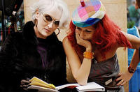 Meryl Streep confers with costume designer Patricia Field on the set of