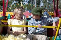 Fern (Dakota Fanning) and Henry Fussy (Julian O'Donnell) take a ride on the ferris wheel in