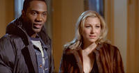 Nashawn Kearse as Isaiah and Tatum O'Neal as Erica in
