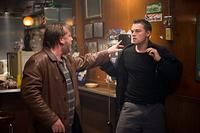 Costello's henchman, French (Ray Winstone), throws Billy Costigan (Leonardo DiCaprio) into a wall after a scuffle with a bar patron in