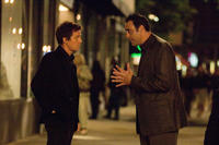 Alex Fletcher (Hugh Grant) and his agent Chris Riley (Brad Garrett) in