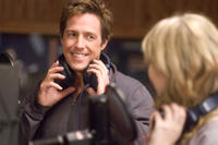 Alex Fletcher (Hugh Grant) and Cora Corman (Haley Bennett) in