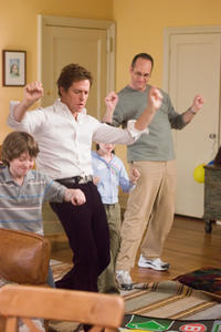 Jeremy Karson, Hugh Grant, Emma Lesser and Adam Grupper dancing '80s style in