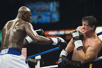 Antonio Tarver and Sylvester Stallone exchange punches in