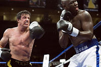 Sylvester Stallone and Antonio Tarver exchange punches in