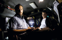 Agent Richard Messner (Ryan Reynolds) and his partner, Agent Donald Carruthers (Ray Liotta), hold surveillance in