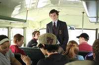 Charlie Bartlett (Anton Yelchin) rides the bus to his first day of public school in