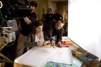 Sandra Bullock and director Mennan Yapo on the set of
