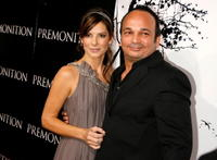 Sandra Bullock and director Mennan Yapo at the Hollywood premiere of