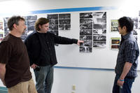 Art director Simon Murton, writer/director Kevin Munroe and environment and color design artist Steve Jung look at storyboards for