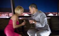 Ellen Barkin as Abigail Sponder and Matt Damon as Linus Caldwell in