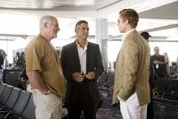 Producer Jerry Weintraub, George Clooney and Brad Pitt on the set of