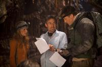 Anita Briem, Director Eric Brevig and Brendan Fraser on the set of