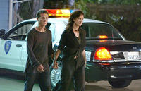 Kale Brecht (Shia Labeouf) is led away from some police activity by his mom, Julie (Carrie-Anne Moss) in