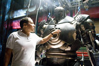 "Director/Executive Producer Jon Favreau examines the Iron Monger armor on the set of ""Iron Man."""