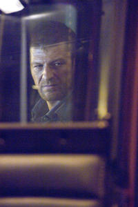 Sean Bean stars as the menacing hitcher in